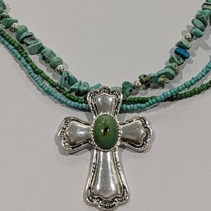 Turquoise colored silver toned cross necklace